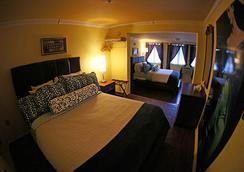 飞马国际酒店 - 基韦斯特 - 睡房