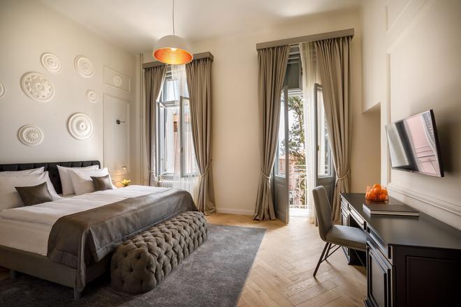 因佩里亚尔雷米森斯优品传统酒店 - 奥帕提亚 - 睡房
