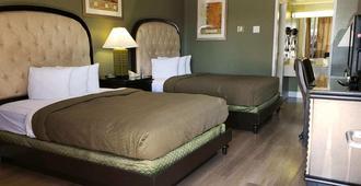 绿树长住汽车旅馆 - 维克多维尔 - 睡房