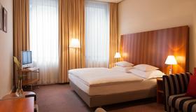 达斯里雅斯特酒店 - 维也纳 - 睡房
