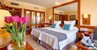 阿德赫格瑞考斯塔酒店 - 阿德耶 - 睡房