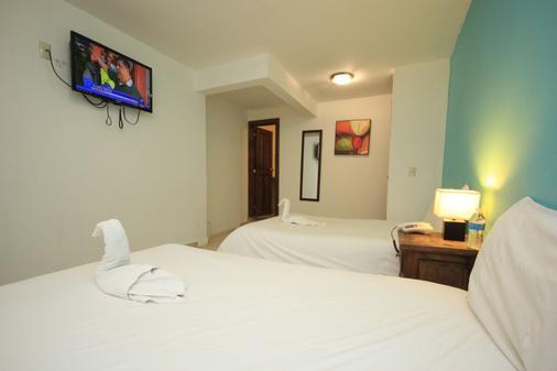 怡和代卢斯酒店 - 圣克里斯托瓦尔-德拉斯卡萨斯 - 睡房