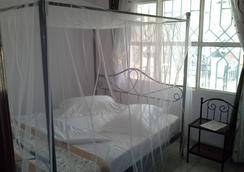 半径客人公寓住宿加早餐旅馆 - Kigali - 睡房