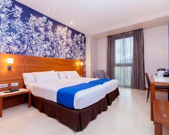毕尔巴鄂格兰酒店 - 毕尔巴鄂 - 睡房