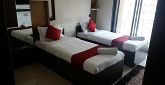 Ssapphires Hospitality Business Pvt Ltd - 孟买 - 睡房