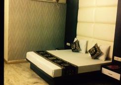 Hotel Karat 87 Inn - 新德里 - 睡房