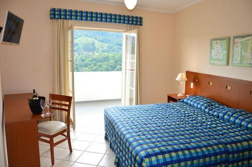 全景温泉酒店 - 阿瓜斯-迪林多亚 - 睡房