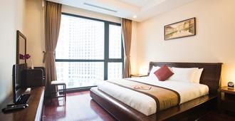 温豪姆斯皇家城市公寓式酒店 - 河内 - 睡房