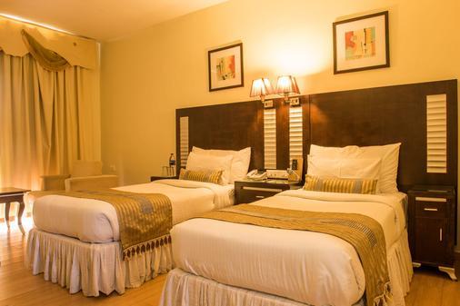 红枫酒店 - 印多尔 - 睡房