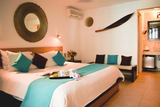 蒂库尔民宿精品酒店 - 路赛住宅酒店 - 卡门海滩 - 睡房