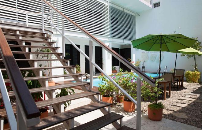 蒂库尔民宿精品酒店 - 路赛住宅酒店 - 卡门海滩 - 户外景观
