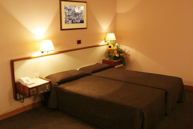 特利托尼罗马酒店 - 罗马 - 睡房