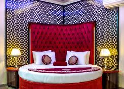 Rose Palace Hotel - 拉合尔 - 睡房