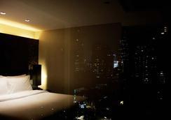 金色郁金香麦迪逊套房酒店 - 曼谷 - 睡房
