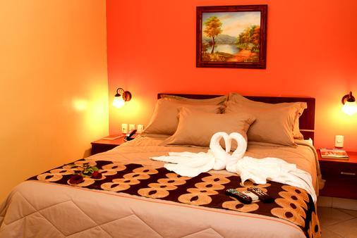 国际总统酒店 - 瓜亚基尔 - 睡房