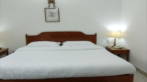 棕榈格林酒店 - 新德里 - 睡房