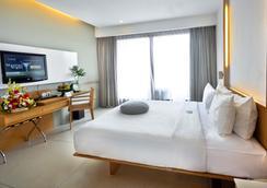 巴厘岛水明漾天堂酒店 - 库塔 - 睡房