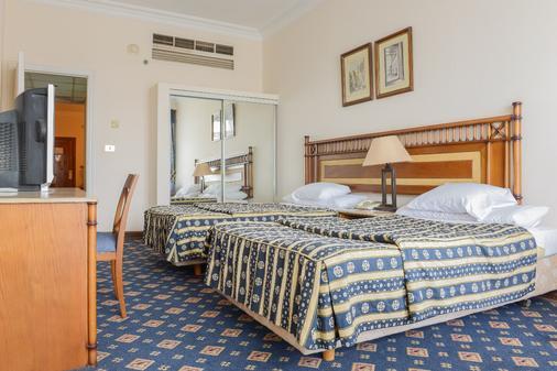 阿曼古尔土姆酒店 - 开罗 - 睡房