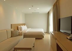 济州岛雾尼酒店 - 济州 - 睡房