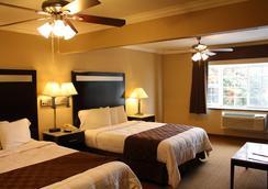 莫罗海湾市中心海空套房酒店 - 莫罗贝 - 睡房