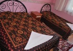 多特季节酒店 - 帕莫卡莱 - 睡房