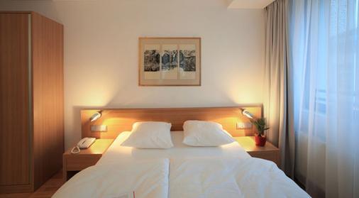 西蒙奇尼酒店 - 卢森堡 - 睡房