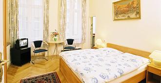 古尼亚酒店 - 柏林 - 睡房