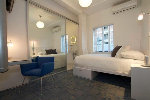 瓦尔登酒店 - 长滩 - 睡房