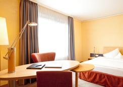 雷马克施泰根博阁酒店 - 奥斯纳布吕克 - 睡房