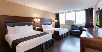 艾斯普莱索蒙特利尔中心区酒店 - 蒙特利尔 - 睡房