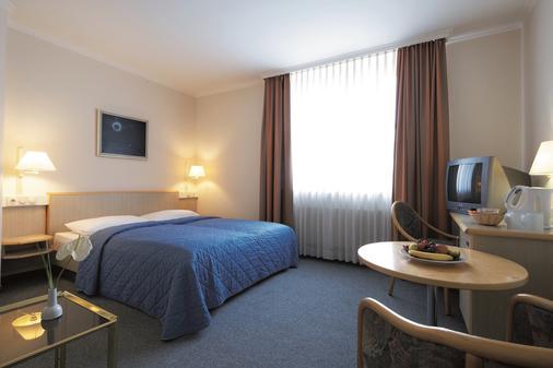 法兰克福城际酒店 - 法兰克福 - 睡房
