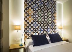 道罗2号舒适酒店 - 格拉纳达 - 睡房