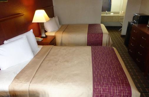 伯锡尔城红顶套房酒店 - 伯锡尔城 - 睡房