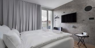 中心酒店 - 卢布尔雅那 - 睡房