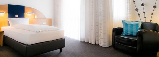 阿尔贝提努酒店 - 埃朗根 - 睡房