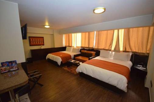 利马优质酒店 - 利马 - 睡房