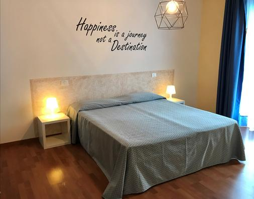 贝娅特丽克丝公寓酒店 - 巴多利诺 - 睡房