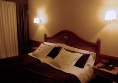 珀蒂酒店 - 帕斯底拉卡萨 - 睡房