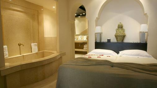 勒斯加丁斯德拉库图比亚酒店 - 马拉喀什 - 睡房