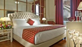 罗马丽笙ghr酒店 - 罗马 - 睡房