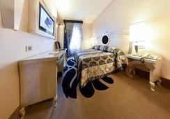 特维基亚赞酒店 - 博洛尼亚 - 睡房