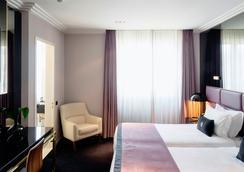 阿尔提斯亚芬尼达酒店 - 里斯本 - 睡房