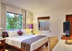 巴厘曼迪拉度假村 - 库塔 - 睡房
