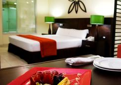 海洋珊瑚松绿石酒店 - 莫雷洛斯港 - 睡房