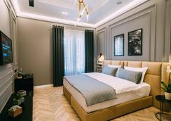 斯特拉中心酒店 - 地拉那 - 睡房