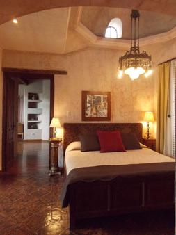 梅松潘扎沃德酒店 - 安地瓜 - 睡房